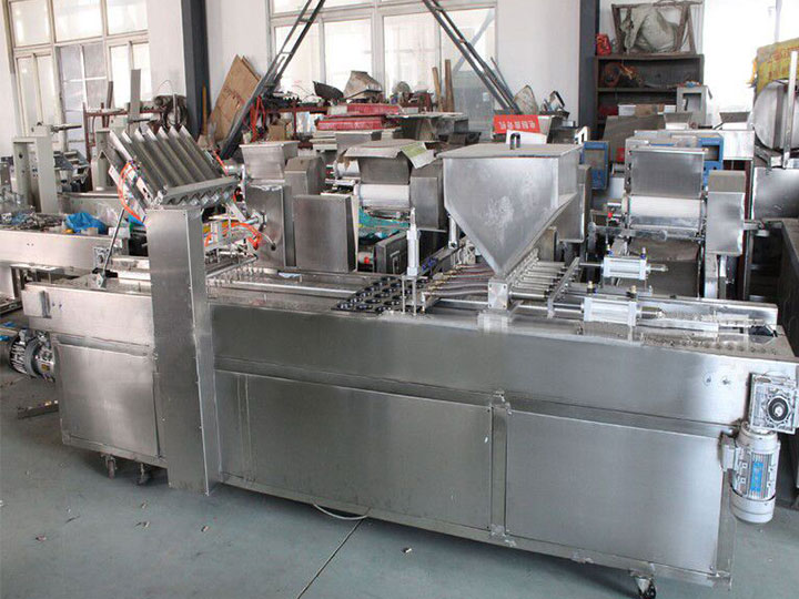 commercial cake depositor with cup filling function