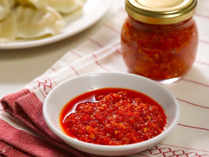 fresh red chili sauce made by chili sauce maker